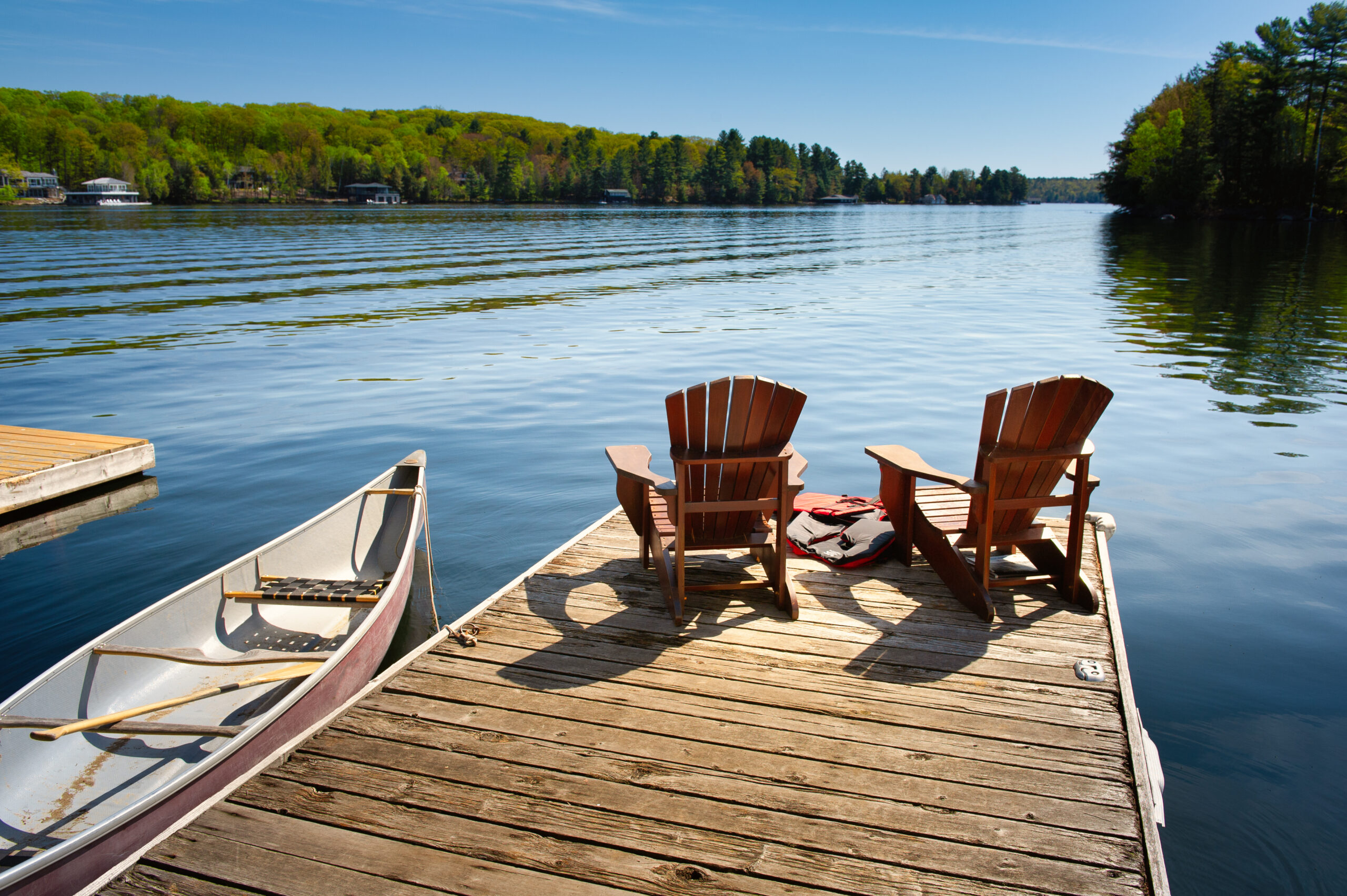 Ontario Canada Lake with canoes and chairs